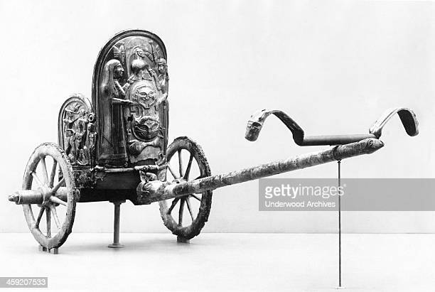 An Etruscan chariot with bronze work from 600 BC that was dug up about 50 miles from Rome New York New York circa 1925 It is in the Metropolitan...