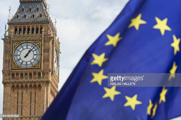 An EU Flag are is seen in front of Elizabeth Tower during a proEU rally at the People's March for Europe against Brexit in Parliament Square in...