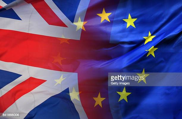 This composite photo illustration of images 650331660651120206 shows the European Union Flag and United Kingdom Flag intertwined BRUSSELS BELGIUM...