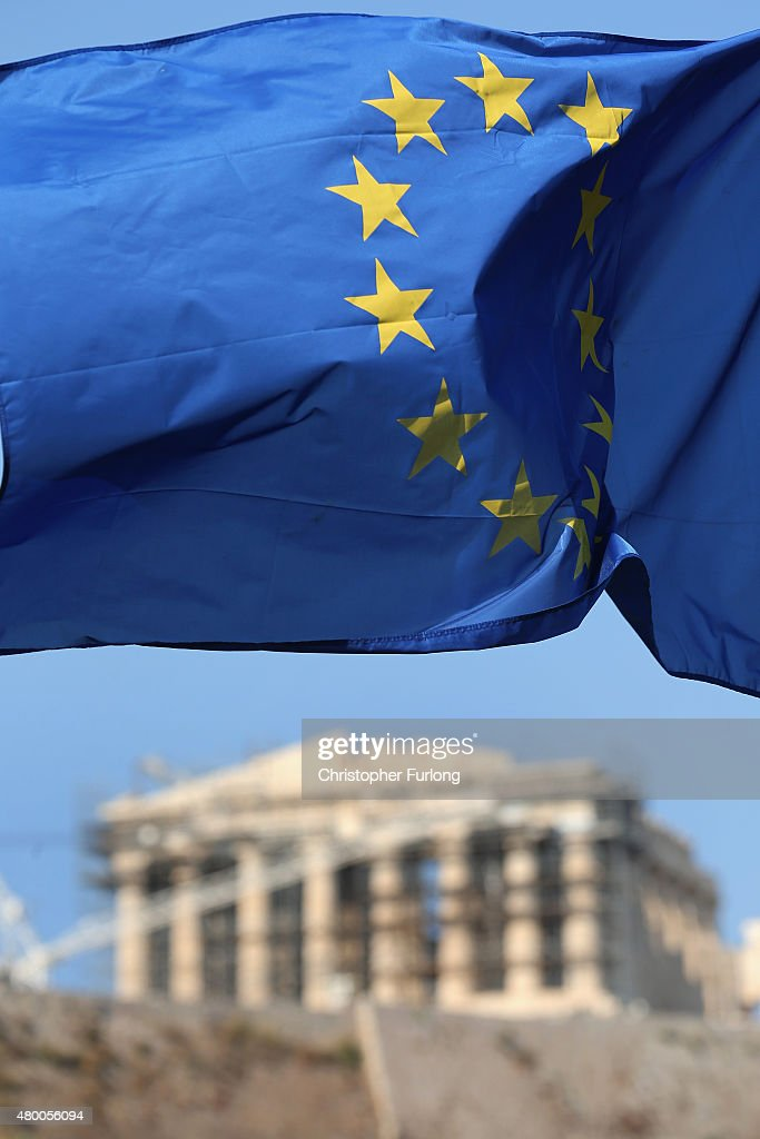 An EU flag flys in front of the ancient Parthenon temple on top of the Acropolis hill on July 9, 2015 in Athens, Greece. The Greek government has hours left to offer Eurozone creditors a viable plan to recovery. Greece's creditors will review the measures before European leaders meet on Sunday to decide on the country's fate and whether it should stay in the euro.
