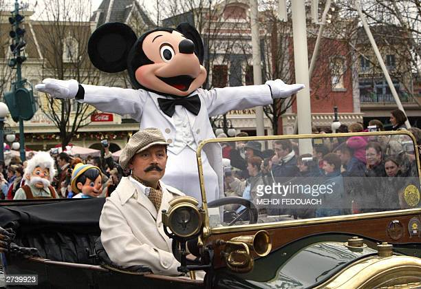 WITH MICKEY TURNS 75 An Euro Disney employee wearing a Mickey Mouse costum parades 18 November 2003 while celebrating the famous mouse's 75 birthday...