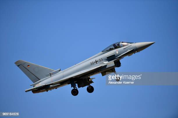 An Eurofighter Typhoon jet performs at Fliegerhorst Wunstorf to take part in an open house day of the Bundeswehr on June 7 2018 in Wunstorf Germany...
