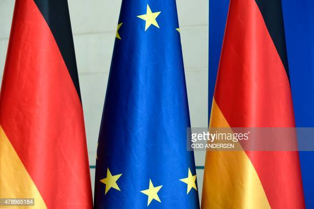 An European Union flag and German national flags are on display at the Chancellery in Berlin on June 29 2015 where German Chancellor Angela Merkel is...