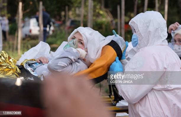 An evacuated patient of the infectious diseases hospital in Constanta, Romania, is pictured on October 1 after a fire broke out in the intensive care...