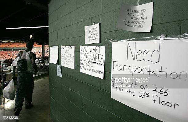 An evacuee passes signs for jobs transportation and Alcoholics Anonymous in the Reliant Astrodome September 7 2005 in Houston Texas The number of...
