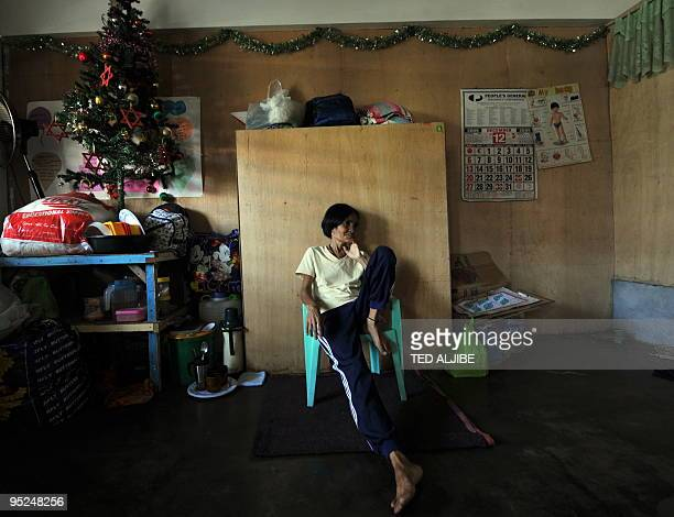 An evacuee sits inside a classroom serving as temporary shelter at an evacuation center in Legazpi City Albay province southeast of Manila December...