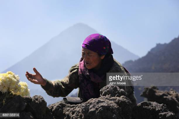 An Evangelical Mayan prays from atop Cerro Quemado a sacred Mayan site February 12 2017 in Almolonga Guatemala Almolonga a Mayan town in the western...