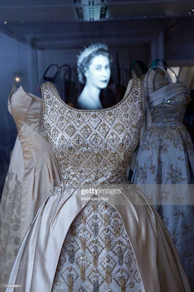 An Evening gown, designed by Norman Hartnell and once worn by the Queen, is displayed in the Fashion Rules Exhibition at Kensington Palace on July 3, 2013 in London, England. The new exhibition will showcase a display of clothes worn by members of the Royal Family in the late twentieth century and opens on July 4.