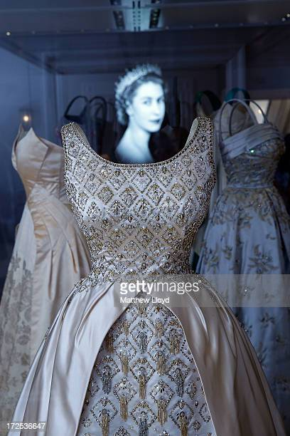 An Evening gown, designed by Norman Hartnell and once worn by the Queen, is displayed in the Fashion Rules Exhibition at Kensington Palace on July 3,...