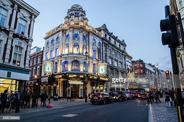 an evening on shaftesbury avenue in soho london - city of westminster london stock pictures, royalty-free photos & images