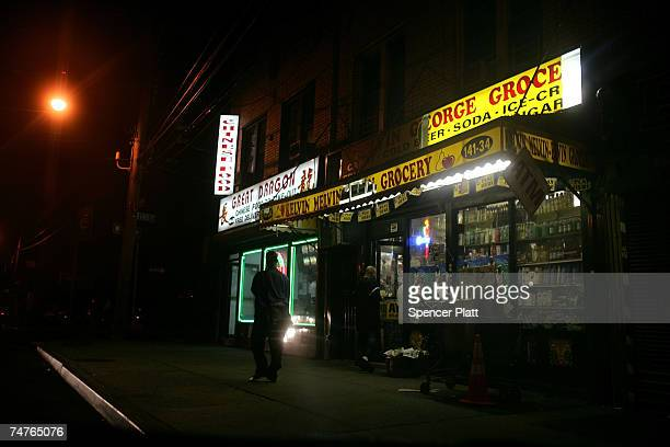 An evening scene outside of a bodega grocery store around the corner from where Bolivar Cruz was killed while working at his bodega last week June 18...