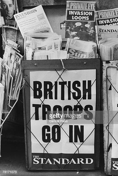 An Evening Standard headline on a London newspaper stand during the Falklands War reads 'British Troops Go In' May 1982