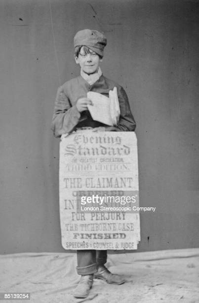 An Evening Standard newspaper boy with a placard announcing the end of the court case against Tichborne claimant Arthur Orton for perjury. Orton was...
