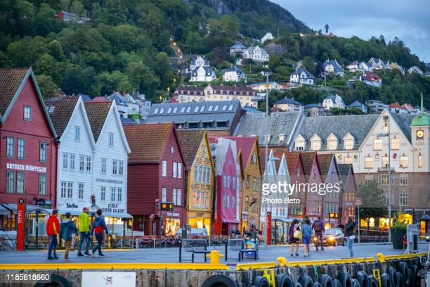 an evening view of the wooden houses in the bryggen district of bergen in norway - ancient stock pictures, royalty-free photos & images