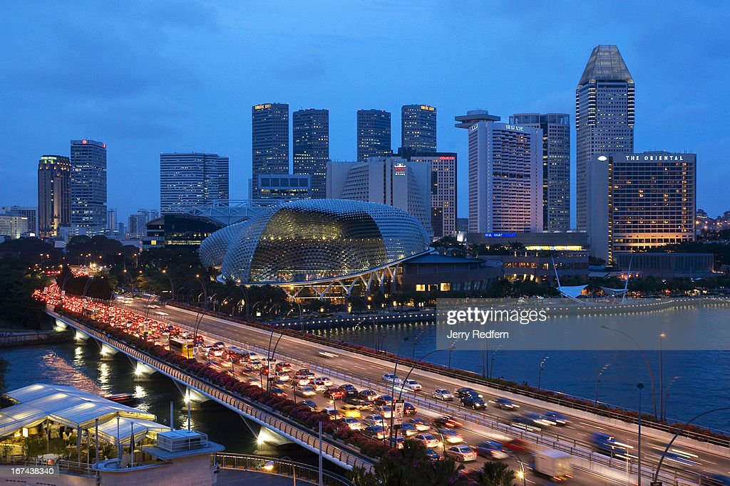An evening view of traffic heading out of city center and past the Esplanade, at center..