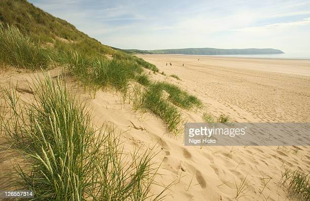 an evening view of woolacombe bay, looking towards the south end of the beach, on the devon coast - bay of water stock pictures, royalty-free photos & images