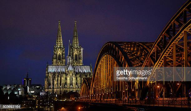 An evening view over the Rhine towards Cologne Cathedral Hohenzollernbrücke Hauptbahnhof main railway station philharmonic concert hall and the...