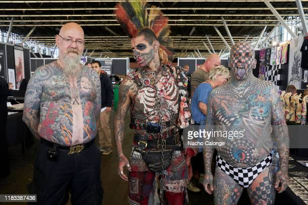 An event attendee poses with Matt Gone and Zombiepunk at the International Tattoo Convention on October 25 2019 in Amsterdam Netherlands Today begins...