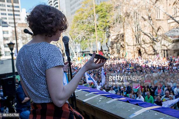 An event organiser calls Prime Minister Tony Abbott's office with a message from the crowd during a rally for marriage equality at Sydney Town Hall...