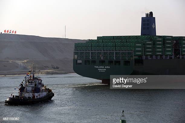 An Evergreen boat flagged in Singapore passes through during the opening ceremony of the new Suez Canal expansion including a new 35km channel on...