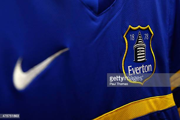 An Everton badge is seen on a replica playing shirt inside the club shop before the Barclays Premier League match between Everton and West Ham at...