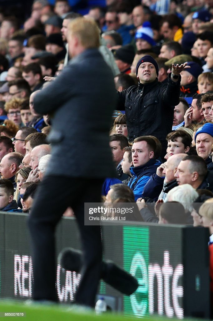 An Everton fan gestures towards manager Ronald Koeman during the Premier League match between Everton and Arsenal at Goodison Park on October 22, 2017 in Liverpool, England.