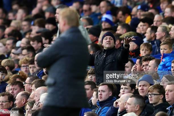 An Everton fan gestures towards manager Ronald Koeman during the Premier League match between Everton and Arsenal at Goodison Park on October 22 2017...