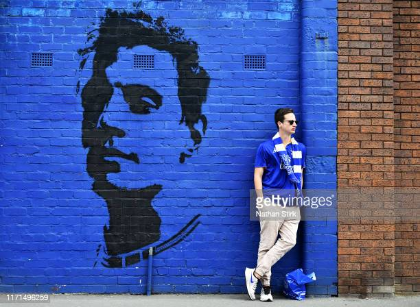 An Everton fan looks on outside the stadium prior to the Premier League match between Everton FC and Wolverhampton Wanderers at Goodison Park on...