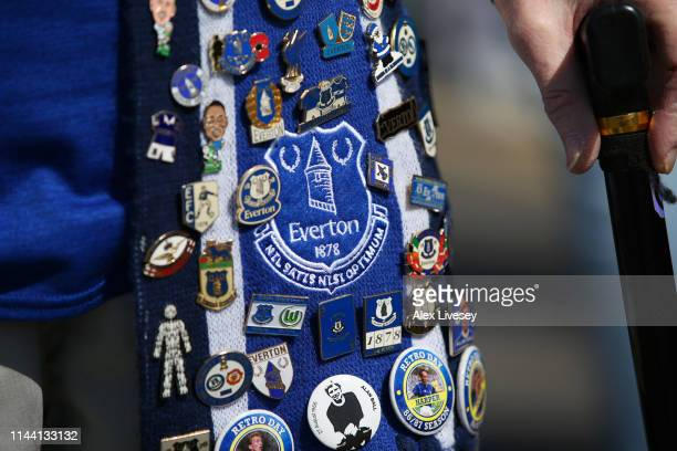 An Everton fan shows off their pin badge collection prior to the Premier League match between Everton FC and Manchester United at Goodison Park on...