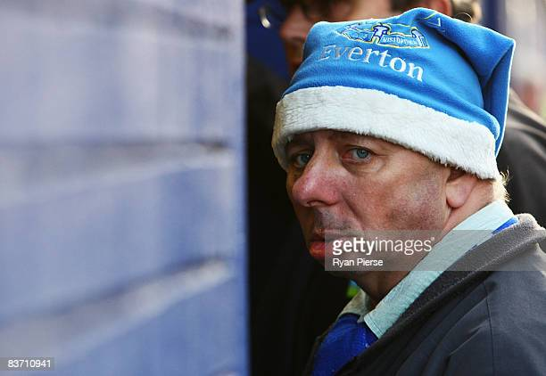 An Everton fan waits outside the ground before the Barclays Premier League match between Everton and Middlesbrough at Goodison Park on November 16...