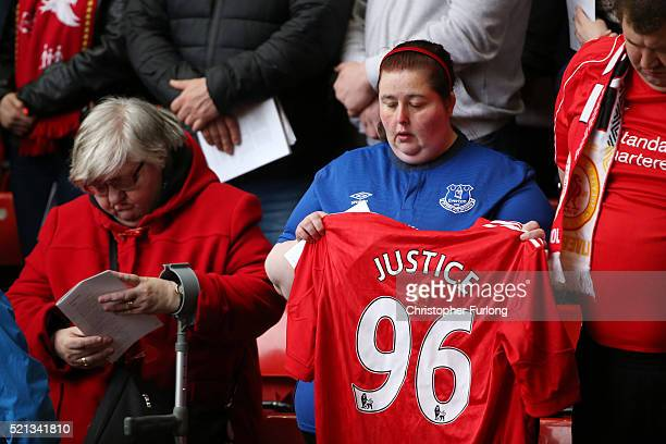An Everton FC supporter holds up a Liverpool FC supporters shirt during a memorial service to mark the 27th anniversary of the Hillsborough disaster...