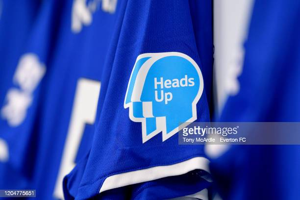 An Everton shirt hangs in the dressing room featuring a Heads Up badge on the sleeve at Goodison Park before the Premier League match between Everton...