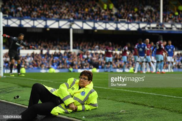 An Everton steward observes the crowd during the Premier League match between Everton FC and West Ham United at Goodison Park on September 16 2018 in...