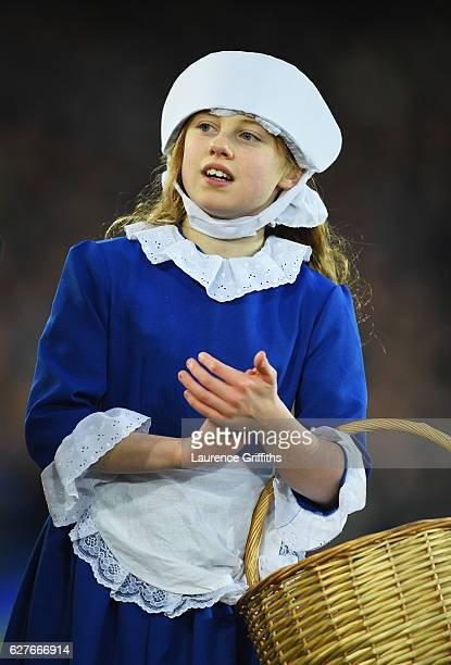 An Everton toffee girl looks on prior to the Premier League match between Everton and Manchester United at Goodison Park on December 4, 2016 in...