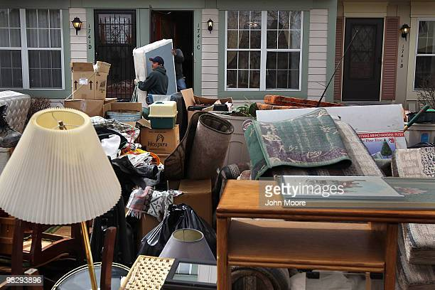 An eviction team removes belongings from an apartment on April 6, 2010 in Aurora, Colorado. A family had failed to pay rent for almost three months...