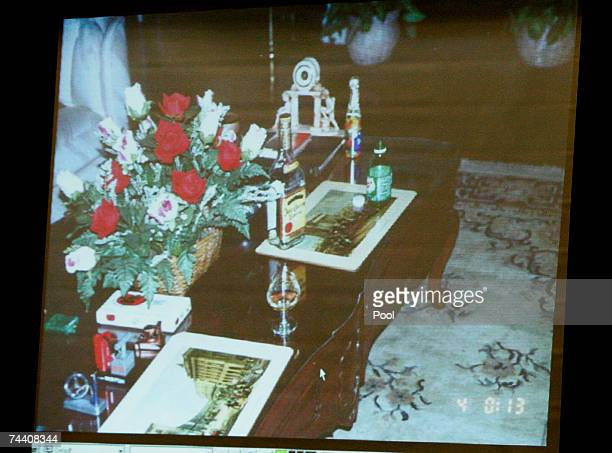 An evidence photograph taken in the living room of Phil Spector?s house is displayed on a screen during the morning session of Spector's murder trial...