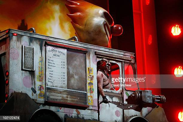 An evil clown character drives onstage as Sony announces its new version of Twisted Metal for Playstation 3 at the Shrine Theater on opening day of...