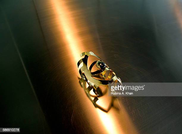 An Evil Eye handcuff made in 18K gold by Lebanese born Dubaibased jewelry designer Nadine Kanso for her Bil Arabi line at Dubai Design District on...