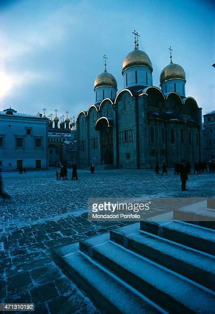 An evocative sight of the early morning in the square of the Dormition Cathedral in the Kremlin with the pavement slightly covered with snow and a...