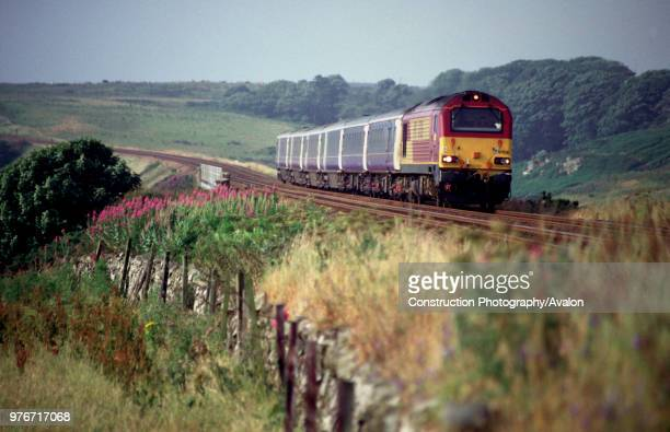 An EWS Class 67 pullls a Caledonian Sleeper service northbound shortly after passing through Stonehaven. This train started its journey at London...