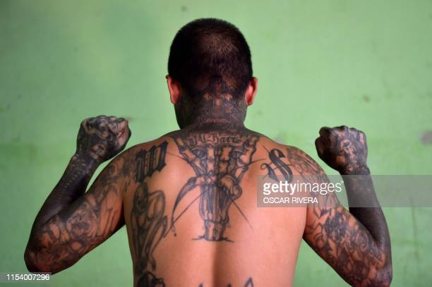 An ex member of the MS-13 gang is pictured at Santa Ana prison, 60 km northwest of San Salvador, on May 21, 2019. - Former members of Salvadoran...