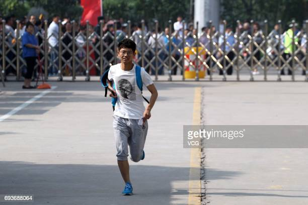 An examinee runs into the exam room during the national college entrance examination on June 7 2017 in Xuchang Henan Province of China Over 9 million...