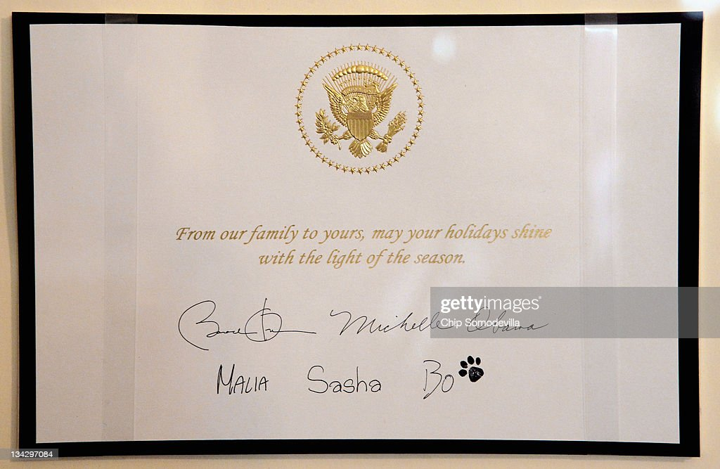 An example of the White House Christmas Card is on display in the East Garden Room during the first viewing of the 2011 White House Christmas decorations November 30, 2011 in Washington, DC. The theme, 'Shine Give, Share,' runs throught the White House with a 400-pound White House Gingerbread House and 37 Christmas trees, including the official 18-foot 6-inch balsam fir tree in the Blue Room that honors Blue Star military families.