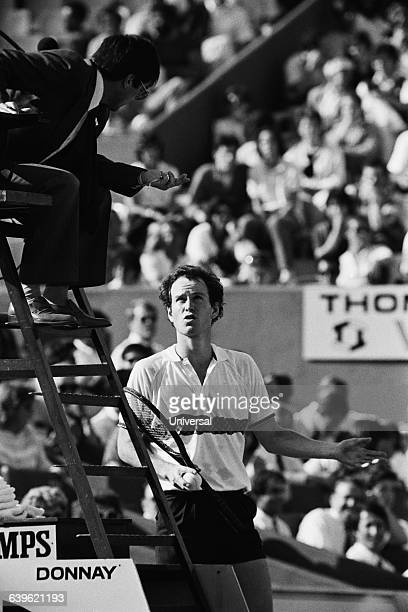 An exasperated John McEnroe challenges the umpire's decision during the men's singles at the 1985 Roland Garros French Open