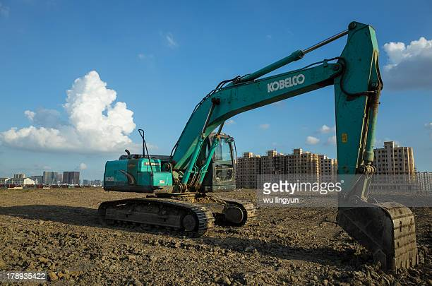 An excavating machine on the formed land of real estate construction site.