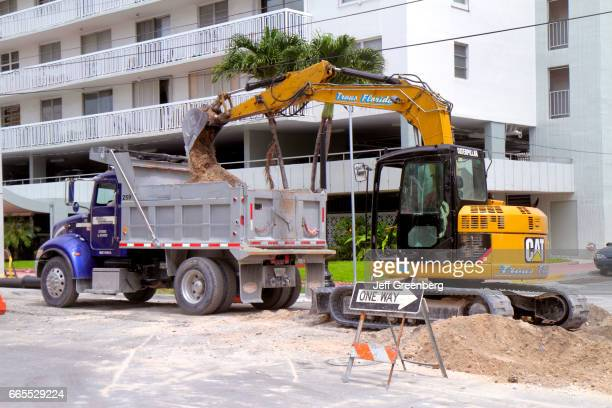 An excavator and dump truck on Ocean Drive