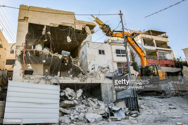 An excavator commissioned by Palestinian Jerusalem resident Ahmed Obaid demolishes Obaid's home in the mostly-Arab east Jerusalem neighbourhood of...