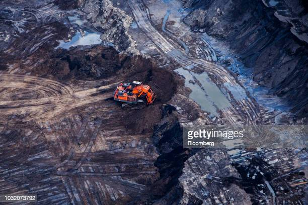 An excavator is seen at the Suncor Energy Inc Millennium mine in this aerial photograph taken above the Athabasca oil sands near Fort McMurray...