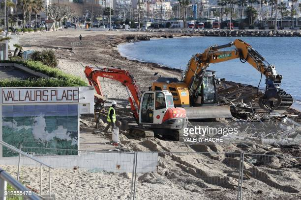 An excavator is used to demolish restaurants on Vallauris Beach in GolfeJuan southeastern France on January 31 2018 The three establishments which...