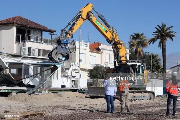 An excavator is used to demolish three restaurants on Vallauris Beach in GolfeJuan southeastern France on January 31 2018 The three establishments...